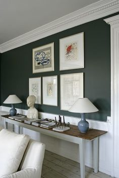 Our dining room is going to have white wainscoting and trim, white ceiling, and dark green walls, similar to this pic. Go Green!