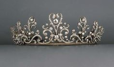 c1880 A fine antique diamond tiara / necklace. Designed as a series of graduated old-cut diamond scrolls each suspending a stylised fleur-de-lys pendant to the central collet and twin scroll motif, mounted in silver and gold.