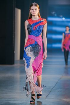 Christopher Kane's collection included a series of collaged lace pieces featuring silhouetted human forms. (Photo: Nowfashion)