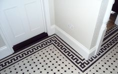 Edwardian renovation - note the panelled door, stepped skirting board and mosaic tiles!