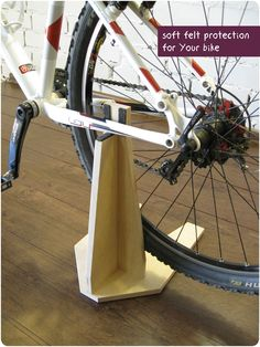 Bike stand, woodden bike holder, bicycle accessories. Buy it here: https://www.etsy.com/shop/BikeWoodHome #bicycleaccessories