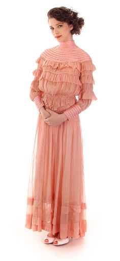 Rare vintage rose pink cotton organza Victorian two piece dress, with a pigeon breast blouse thats quite full in front. It has a pretty yoke of silk satin ribbons sewn in concentric circles with uniqu