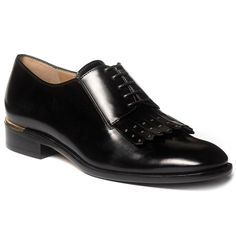 Check out this black leather oxford for women who set their own rules. Tailored with a metallic heel wrap and studded classic kiltie. Pair with dress slacks at the office or make a bold statement on the weekend with bright corduroys.