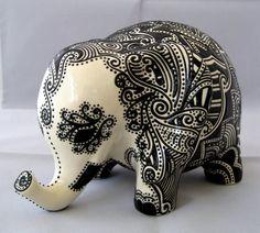 Ceramic Elephant -- Embossed Black Design on White Glazed Elephant Bank. $120.00, via Etsy.