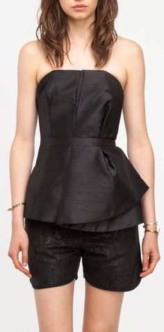 Pleated strapless top from Cameo with back zip closure, flared silhouette  below the waist and a gentle sheen finish.