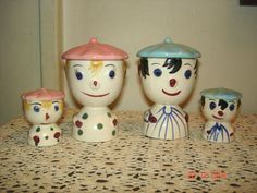 There is another set farther down, but this one might be Superman - note the sexy lock of hair over his forehead?  VINTAGE WHIMSICAL JAPAN HONEYMOONERS DOUBLE EGG CUPS W/SHAKERS