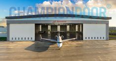 The Champion Door has paid special attention to the style and appearance of the hangar doors, particularly to the smooth operation of the door fabrics. Jumbo Jet, Exterior Doors, Folded Up, Champion, Aircraft, Fabrics, Smooth, Construction, Style