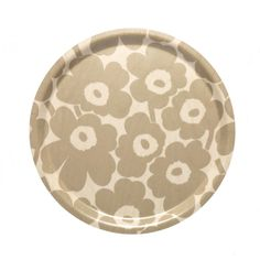 Made of laminated birch plywood, this lightweight tray features the light brown and beige Mini Unikko (poppy) pattern. Unikko (poppy) was born in 1964 after Armi Ratia, Marimekko's founder, had announced that Marimekko would never print a flow Marimekko, Textile Patterns, Flower Patterns, Nordic Interior Design, Poppy Pattern, Round Tray, Japanese Patterns, Citronella, Illuminated Letters