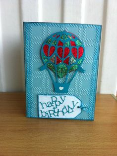 "Hot air balloon card created using the ""Victorian Romance Cartridge"" on a cricut.  The background is embossed using a tartan folder on a cuttlebug"