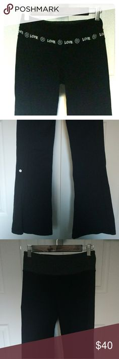 """Lululemon Reversible Groove Pants Lululemon reversible black groove yoga pants. One side says love on the waist band and the other side is grey. Key pocket. Size 4. Gently worn and loved. Regular length. Never hemmed. Length 38"""", inseam 30"""". lululemon athletica Pants"""