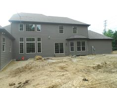 Back of the house with James Hardie Lap Siding in Timber Bark.