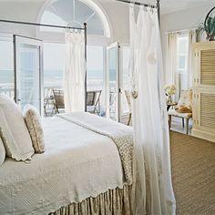 ღღ Romantic Getaway ~~ A fanlight window above the French doors lets even more light into this breezy master bedroom.