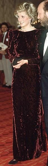 Burgundy velvet long-sleeved dress with a low V back.  Designer: Catherine Walker. Price raised at auction: $ 26,450