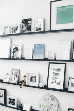 black floating shelves, gallery wall, photography