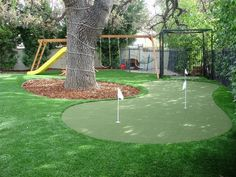 Artificial turf putting green- perfect for the avid golfer, to get a little practice in!