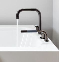 vola contemporary minimalist deck mount bath filler with handshower in black with lever handles and 90 degree spout - the ultimate guide to luxury plumbing by the delight of design Undermount Stainless Steel Sink, Undermount Sink, Bath Fixtures, Plumbing Fixtures, Sink Countertop, Countertops, Building A New Home, Designer, House Design