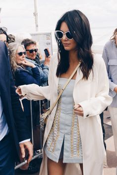 style your favorite pair of cat eye sunglasses like Kendall Jenner with your favorite blue mini dress and long white trench coat