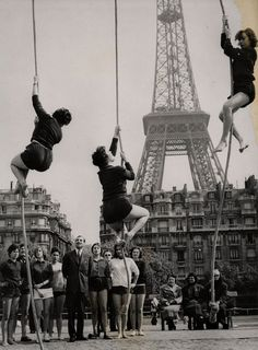 1960's Paris: Girls climbing ropes for their final exam at the Academy for Physical Education.