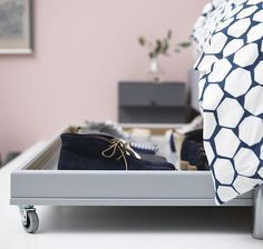 Can you believe this organizer is an IKEA kitchen cabinet door? Add wheels so you can push it deep under the bed, then pull it out with ease when you need to grab your Saturday-errand shoes and go. Click through for this and more under-bed organization ideas.