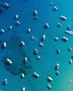 The blue waters on the edge of the Mediterranean Sea make the boats look as if they're floating in the sky.