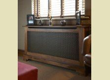 """A hand crafted American Black Walnut radiator cover with """"antiqued"""" brass grille, by Hallidays UK."""