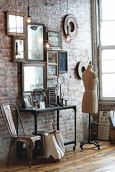 Mainly the dress form, but love the industrial lights and array of mirrors and frames.