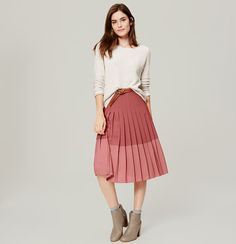 """In a two-hue scheme, we can't help but fall for this prettily pleated midi. Back zip. Lined. 27"""" long."""