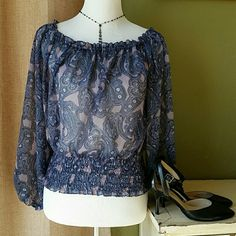 Michael Kors blue and lavender sheer blouse Blue and lavender paisley sheer blouse from Michael Kors. It is a Petite Medium. This is a very pretty long sleeve top with a ruffeled, scalloped neckline and elastic waistband. MICHAEL Michael Kors Tops Blouses