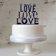'it must be love' cake topper by miss cake | notonthehighstreet.com