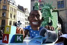 OBAMA, LAUGHINGSTOCK OF THE WORLD ~~ These floats were part of the annual Carnival Parade in Germany watched by an estimated three million people in three German cities including Düsseldorf. Doesn't it make you so proud that the world is laughing at the president of the USA!?! (HL)
