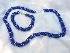 spiral necklace set in vibrant blue and silver