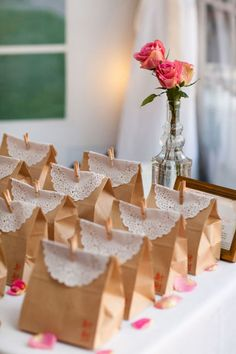 "Tea parties, laces, and babydoll faces...That's what little girls are made of...A cute tea party or ""girly"" theme with a simple favor. (Paper bags with candy or tea inside, fold them over, place a lace doily, and a mini clothes pin to hold it together)"