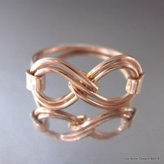 This gorgeous artisan made ring is made out of two parts. The top of the ring - the double infinity symbol if formed uniquely out of 18 gauge copper wire. The ring shank, hammer forged is made out of #copperwirerings