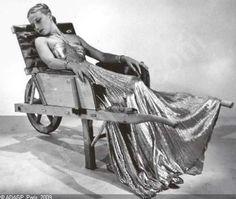 Man Ray, Model in Lucien Lelong gown, seated in wheelbarrow by Oscar Dominguez, 1937.