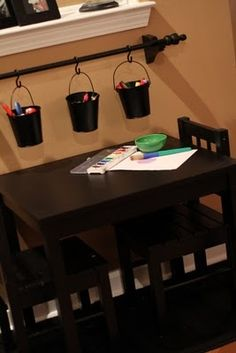 table and chairs with hanging buckets for storage