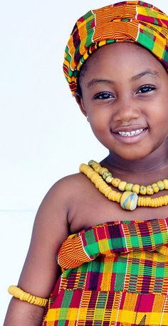 An African child shows her beauty in a traditional Ghanaian outfit.