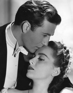 "Olivia de Havilland with the very dapper Jeffrey Lynn in ""My Lover Came Back"" 1940"