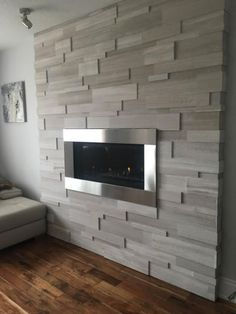 welcome to the art of stone! the art of stone is an interior & exterior stone decor supplier. we offer top quality produ. Living Room Decor Fireplace, Fireplace Tv Wall, Basement Fireplace, Fireplace Remodel, Modern Fireplace, Fireplace Design, Home Living Room, Fireplace Stone, Fireplaces