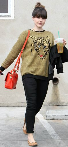 cool, funky outfit - not the colour of the jumper but like the print on the jumper and the contrast of the handbag with everything else.