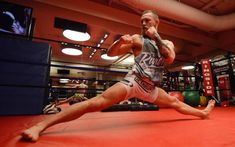 Conor McGregor - Irish MMA Fighter stretching : Shop at CageCult for original #MMA inspired fashion for powerful #MixedMartialArts fighters and savage #UFC fight fans: http://cagecult.com/mma