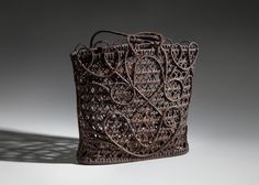 Basket for carrying brass gongs (balen di gangha)  20th century  Ifugao Luzon Cordillera, Philippines plaited construction rattan Fowler Museum at UCLA; Gift of Helen and Dr. Robert Kuhn - See more at: http://www.sfoairport.com/web/page/sfo_museum/about/press_images/exh-basketry.html#sthash.jYvBbVmc.dpuf
