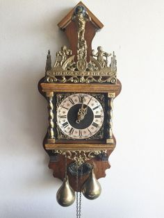Available on eBay this Large Warmink Dutch Vintage Chain Driven Nut Wood Zaanse Wall Clock & Bell, 1976