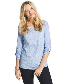 Go casual with this t-shirt. The layered front showcases a burnout paisley pattern.  3/4 sleeves.  Relaxed, boxy style. Length: 26