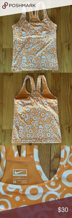 Sz M Nike Built In Bra Active Workout Tank Excellent condition Like new Barely worn! Built in bra Too tight on me now that I had my baby! Orange and white (pale/pastel orange) Racerback Active tank Nike Tops Tank Tops