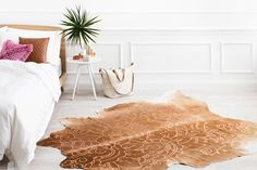 A stunning alchemy of natural hide combined with ethnic vibes and high impact metallics. This whimsical, boho style is the supreme ultimate in laid-back luxe.  The Isola hide is a design collaboration with our sister brand, Amigos de Hoy. Premium quality natural cowhide has been elegantly finished with a metallic devore technique in a batik inspired design. The Caramel base hide is available in either Dark Caramel or Light caramel base, with either gold or copper metallic pattern.
