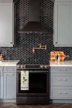 kitchen with black hex tile backsplash and gold pot filler over range Loft Kitchen, Diy Kitchen, Kitchen Design, Kitchen Decor, Black Backsplash, Kitchen Backsplash, Kitchen Black Tiles, Countertop, Black Kitchens