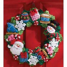 Bucilla Felt Applique Wall Hanging Wreath Kit, 15 by 86363 Christmas Toys Candy Wreath, Felt Wreath, Wreath Crafts, Felt Christmas Ornaments, Christmas Toys, Christmas Stockings, Christmas Wreaths, Christmas Decorations, Applique Wall Hanging