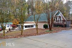 STUNNING ONE OF A KIND HOME!  IMMACULATE HOME ON 4.67 ACRES PRIVATE AND SECLUDED YET ONLY 10 MINS TO I-75 & SHOPPING AT EXIT 218! MUST SEE WITH 3 MASTER SUITES WITH PRIVATE BATHS,  4TH BEDROOM OR OFFICE AND LARGE OPEN LOFT WITH BALCONY!  AMAZING GOURMET KITCHEN W/GRANITE COUNTERTOPS, LOADS OF CABINETS, BRKFAST BAR,DINING RM & 2 STORY OPEN GREAT RM W/STACKED STONE FIREPLACE!  2 MASTER SUITES ON THE MAIN, 1 MASTER UPSTAIRS W/BIG LOFT AREA TO HANG OUT IN!  HM WAS 85% REMO...