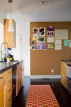 an entire wall of cork looks textural and cool, but doubles as a great hanging spot!