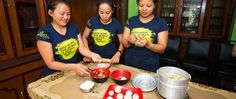 Three young women in a momo (dumpling) making demonstration. Through a program with SASANE, these young women who are trafficking survivors, put on momo demonstrations for tourists and provide the tourists lunch to generate income to support their livelihoods.